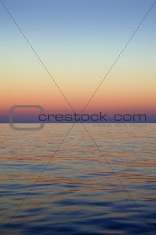 Beautiful sunset sunrise over blue sea ocean red  sky