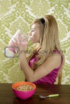retro woman drinking strawberry milkshake