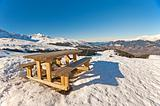 Picnic table on a snowy mountain top