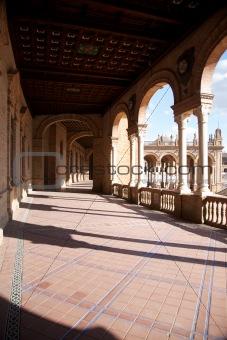 arcade at public Spain Square in Seville