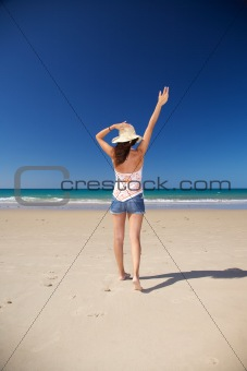 happy straw hat woman at beach