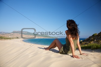 woman sits over Bolonia beach