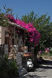 Greek house with bougainvillea and scooter