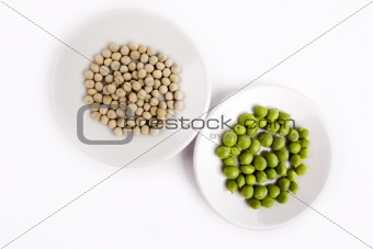 Fresh and dried green peas on plate