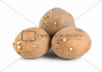 Three raw potatoes