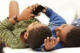 Two boys discovering a smart phone
