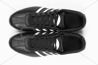 Black sneakers with white strips