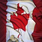 Flag of Canada, fluttering in the breeze, backlit rising sun