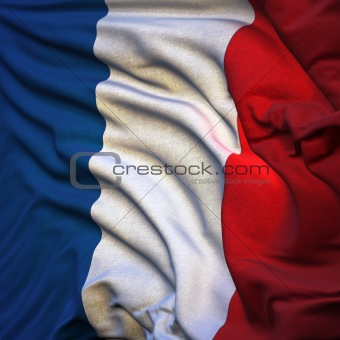 Flag of France, fluttering in the breeze, backlit rising sun