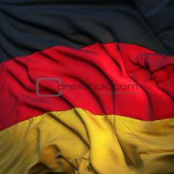 Flag of Germany, fluttering in the breeze, backlit rising sun