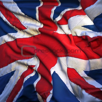 Flag of the United Kingdom, fluttering in the breeze, backlit rising sun