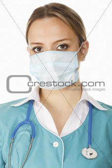 Portrait of female doctor in mask with stethoscope. isolated on