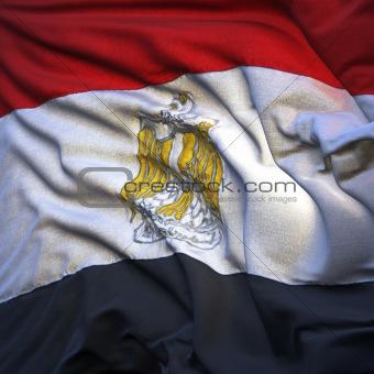 Flag of Egypt, fluttering in the breeze, backlit rising sun