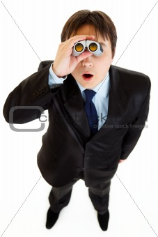 Shocked young businessman looking through binoculars