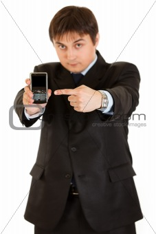 Confident  businessman pointing finger on mobile with blank screen