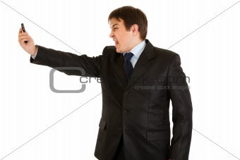 Amazed modern businessman yelling on mobile phone