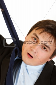 Stressed businessman hanging himself on his necktie