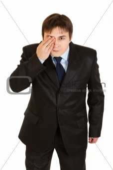 Attentive businessman closed his eyes with his hand