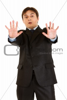 Portrait of scared young businessman