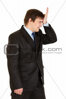 Forgot something businessman holding his hand near forehead
