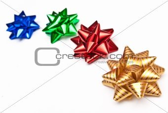 four colorful bows on white background