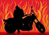 Motorcyclist on background of fire