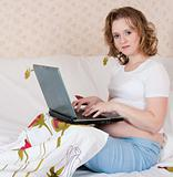Pregnant young woman using a laptop