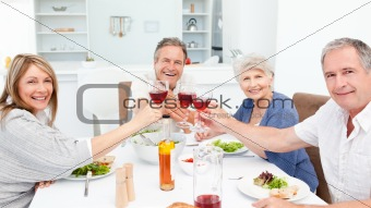 Retired friends toasting together