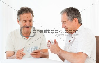 Men playing cards on the table