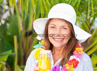 Retired woman drinking a cocktail
