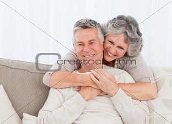 Mature woman hugging her husband