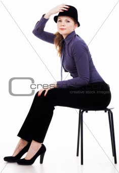 Beautiful young woman posing on a chair