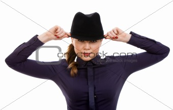 Beautiful young woman holding hat