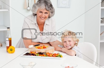Boy and his grandmother looking at the camera