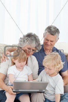 Adorable family looking at the laptop