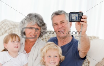 Family taking a photo of themselves 