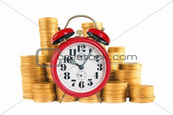 Alarm clock with golden coins on yellow background