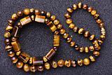 Bracelet and a necklace of tiger eye .