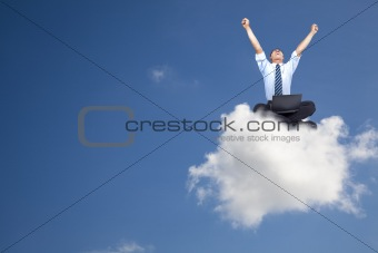 Young businessman with computer sitting on the cloud