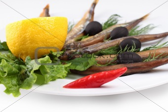 kipper fish on composition with vegetables