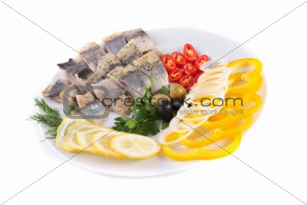 fish on plate with vegetables
