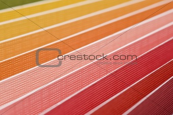 Textured color paper background with shallow depth of field