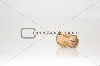 Champagne cork on white with reflection