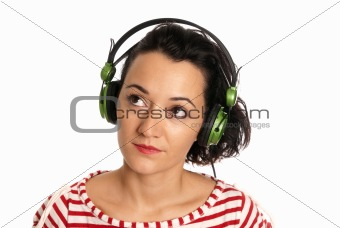 Young woman listening music with headphones isolated on white background