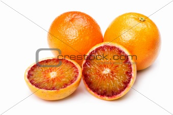 Cutting orange on white