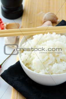 bowl of white fluffy rice with chopsticks