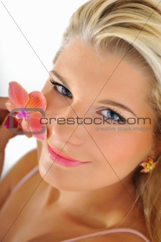 Beautiful young fresh female face with healthy skin