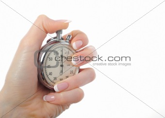Beautiful womans hand with stop watch. isolated on white