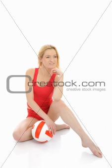 Beautiful sporty girl with volleyball ball. isolated on white