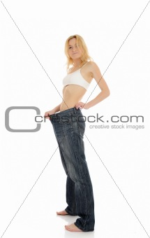 Slim woman in oversized big pants lost her weight. isolated